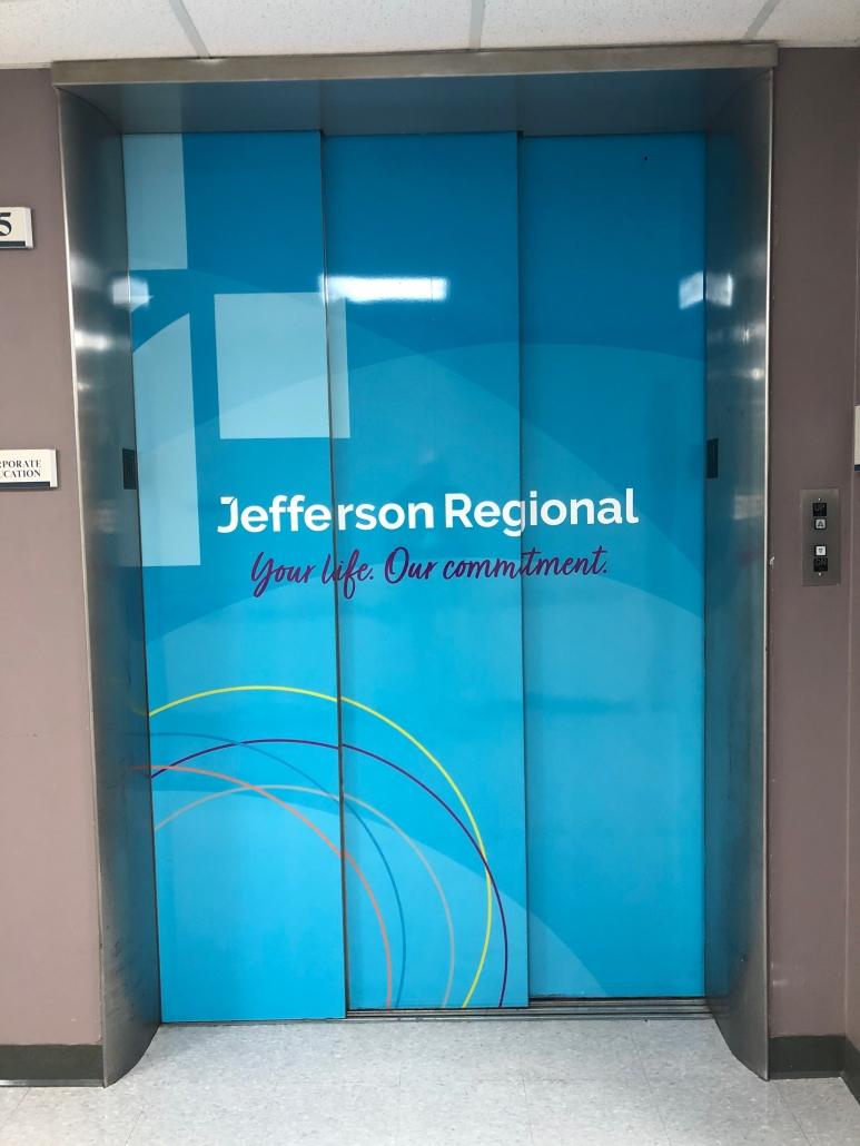 custom elevator wrap, custom elevator decal, custom elevator graphics